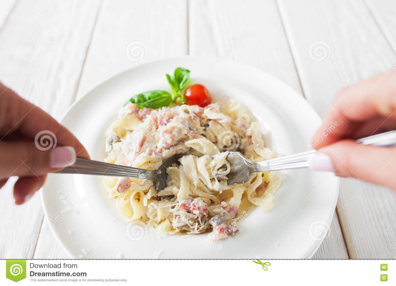 Traditional eating of pasta carbonara, eater pov