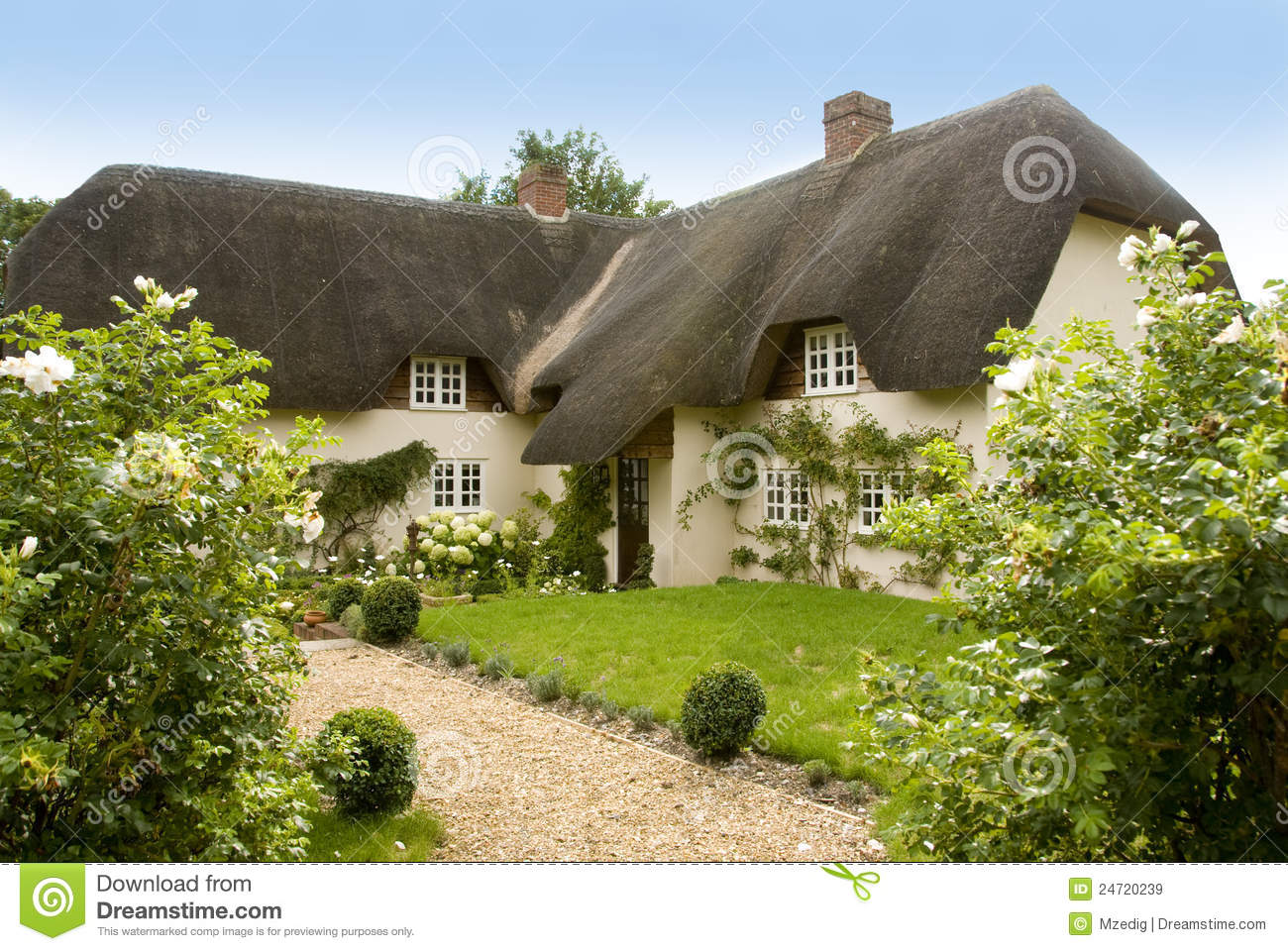 Traditional English Thatched Country Cottage Royalty Free