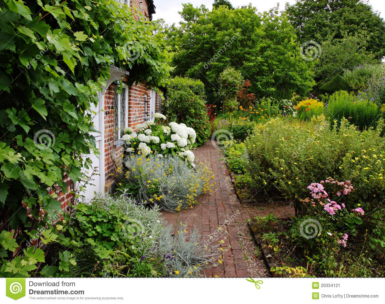 Traditional English Village Cottage And Garden Stock Image
