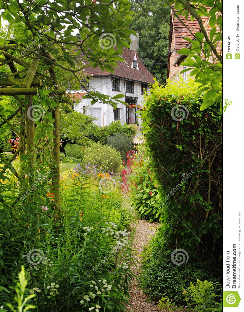 Traditional English Village Cottage And Garden Royalty