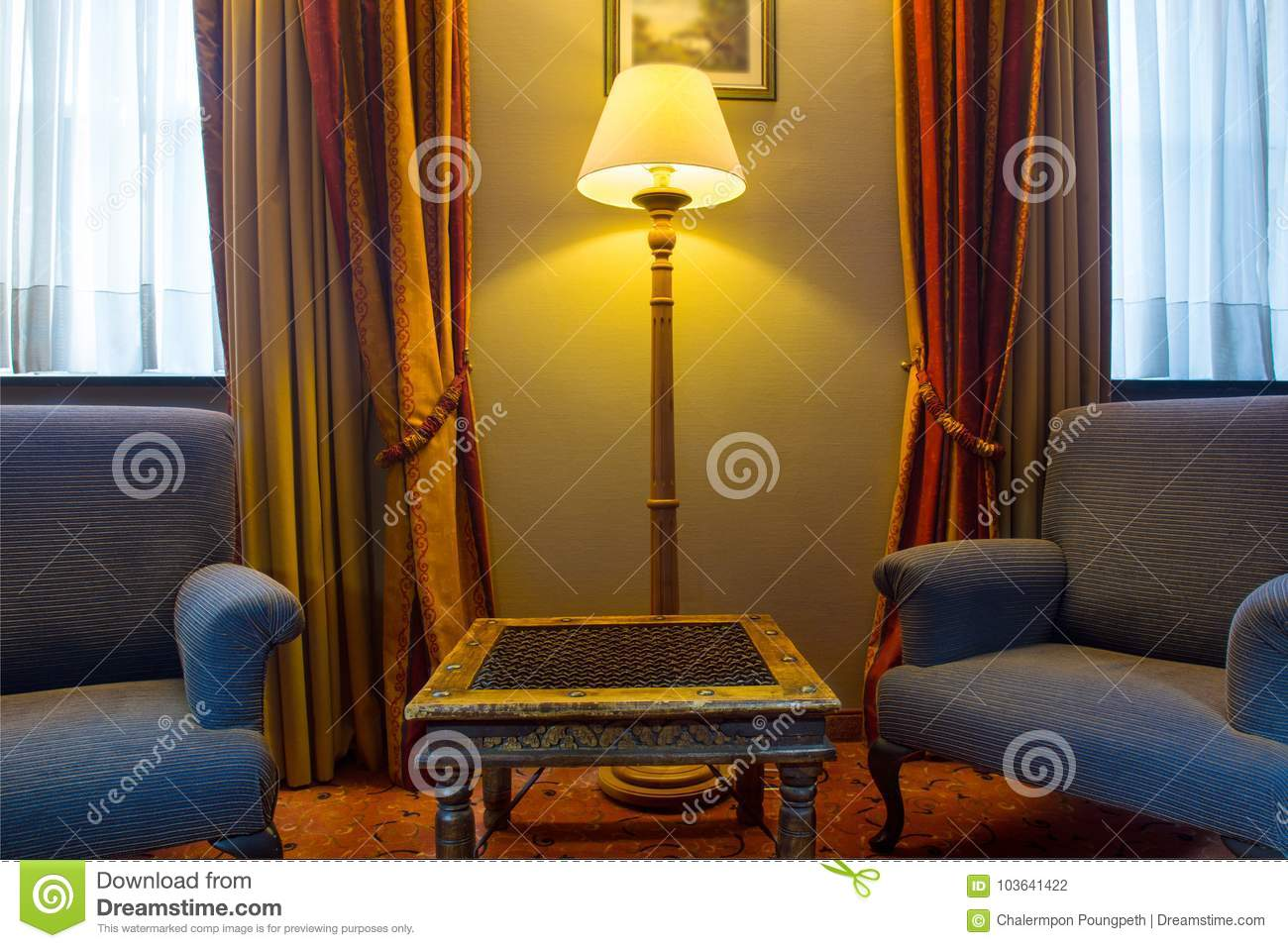 Traditional European Chairs And Side Stand In A Living Room ...