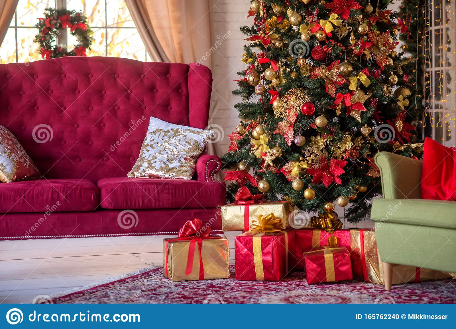 Traditional Festive Advent Interior Decoration Living Room With Maroon Sofa Armchair And Christmas Tree And Gift Boxes Under It Stock Photo Image Of Bows Maroon 165762240