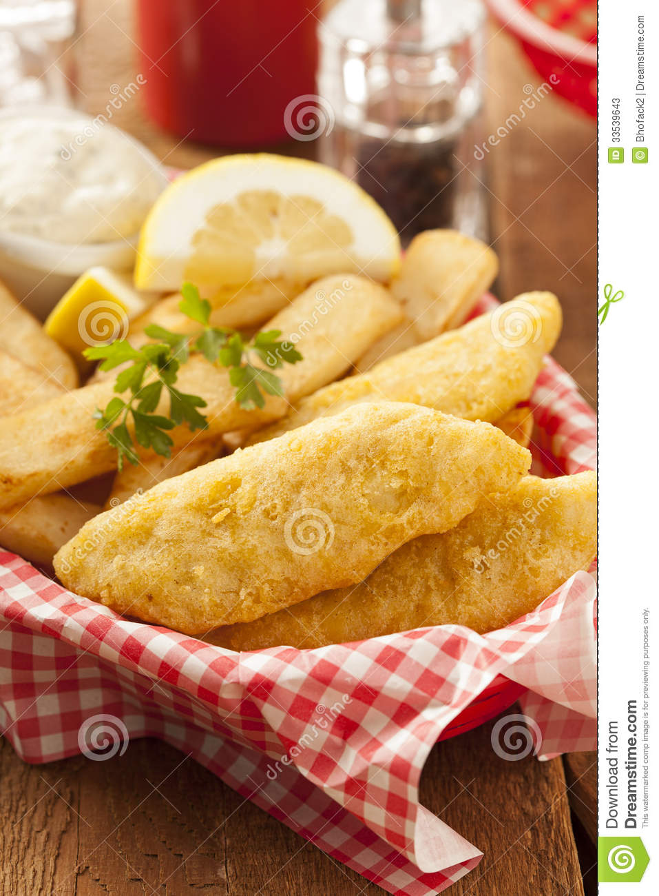 Traditional Fish and Chips with Tartar Sauce.