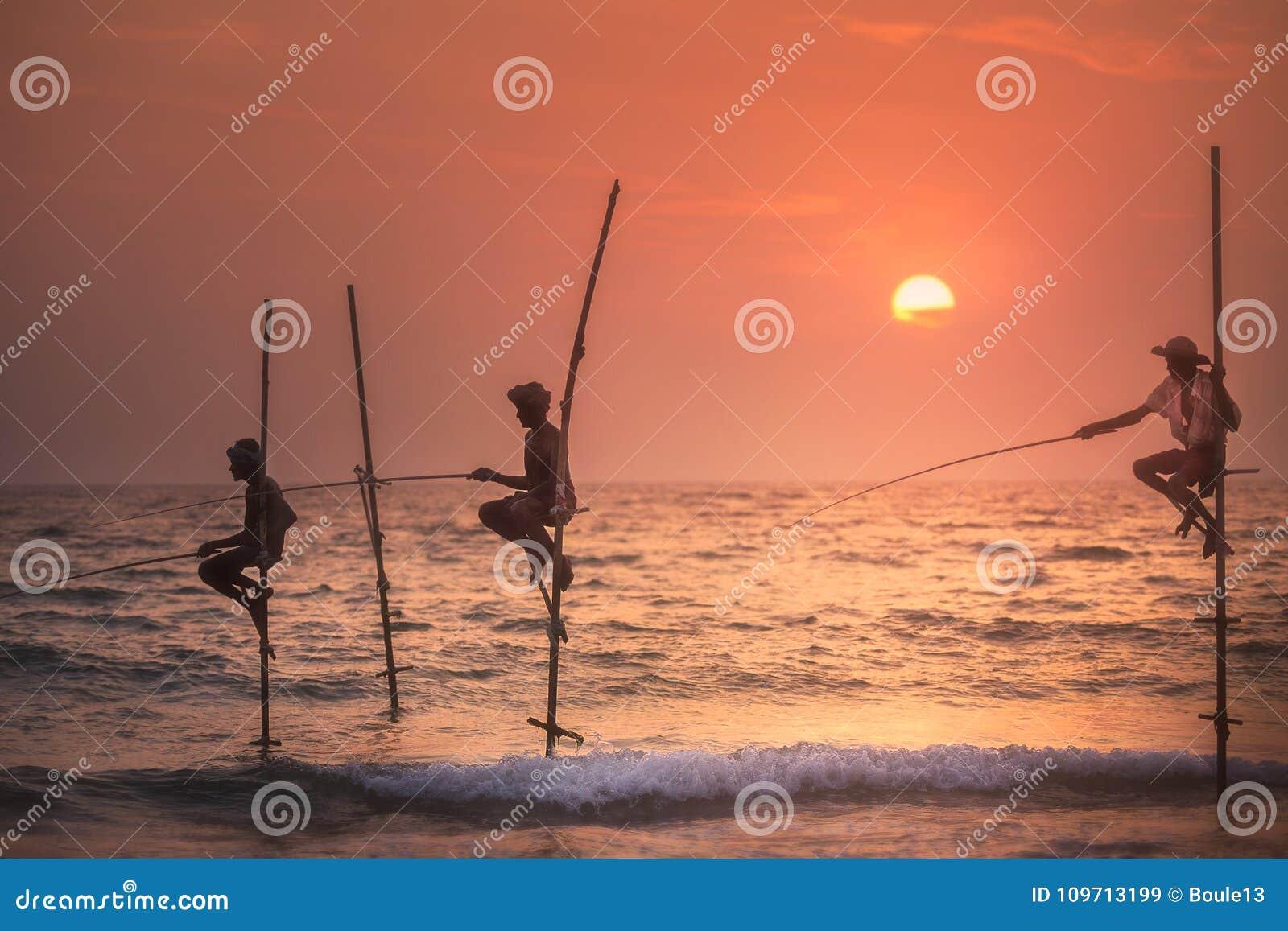 Traditional fishermen at the sunset, Sri Lanka.