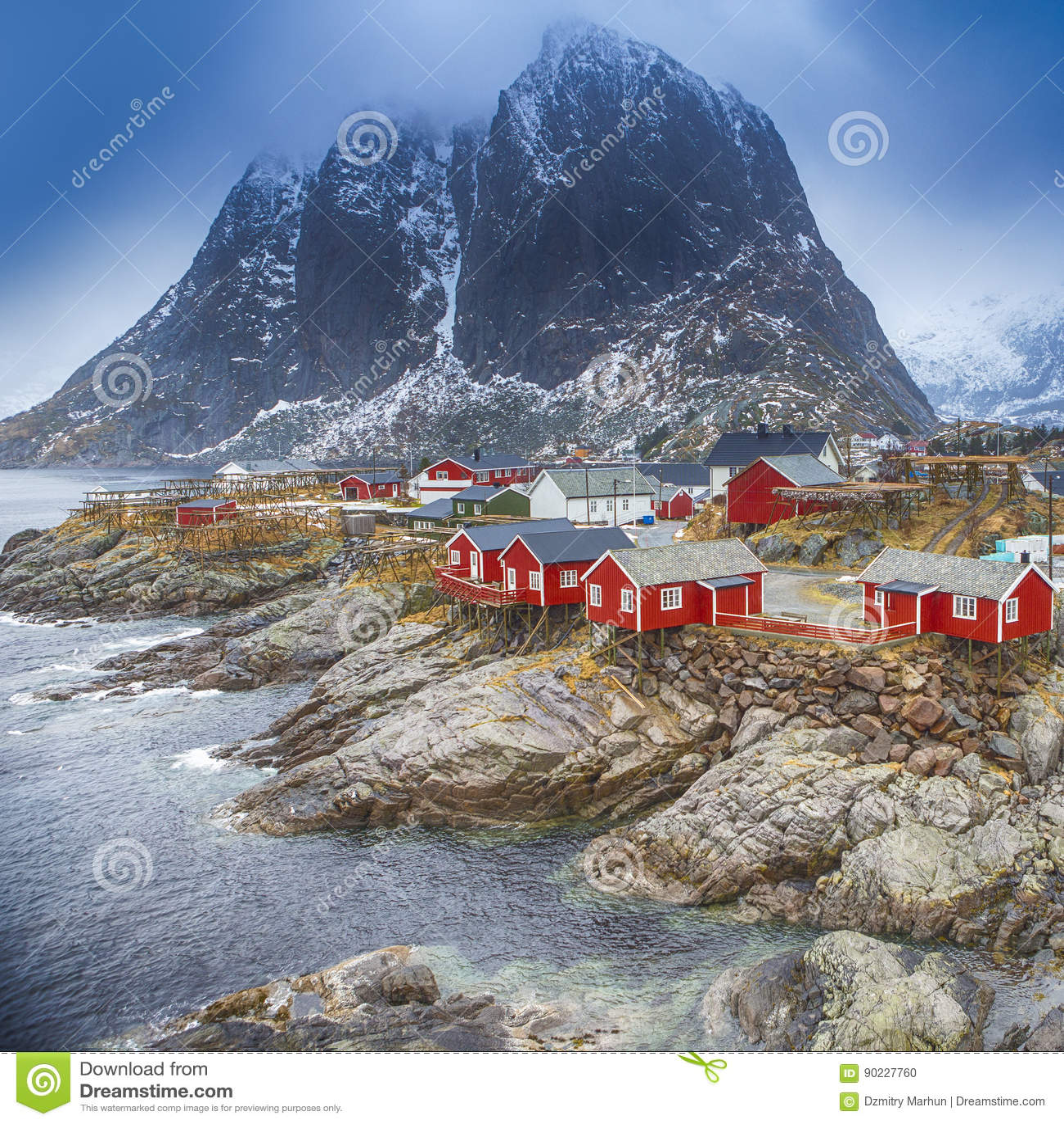 Traditional fishing hut village in hamnoy mountain peak in for Peak fishing times