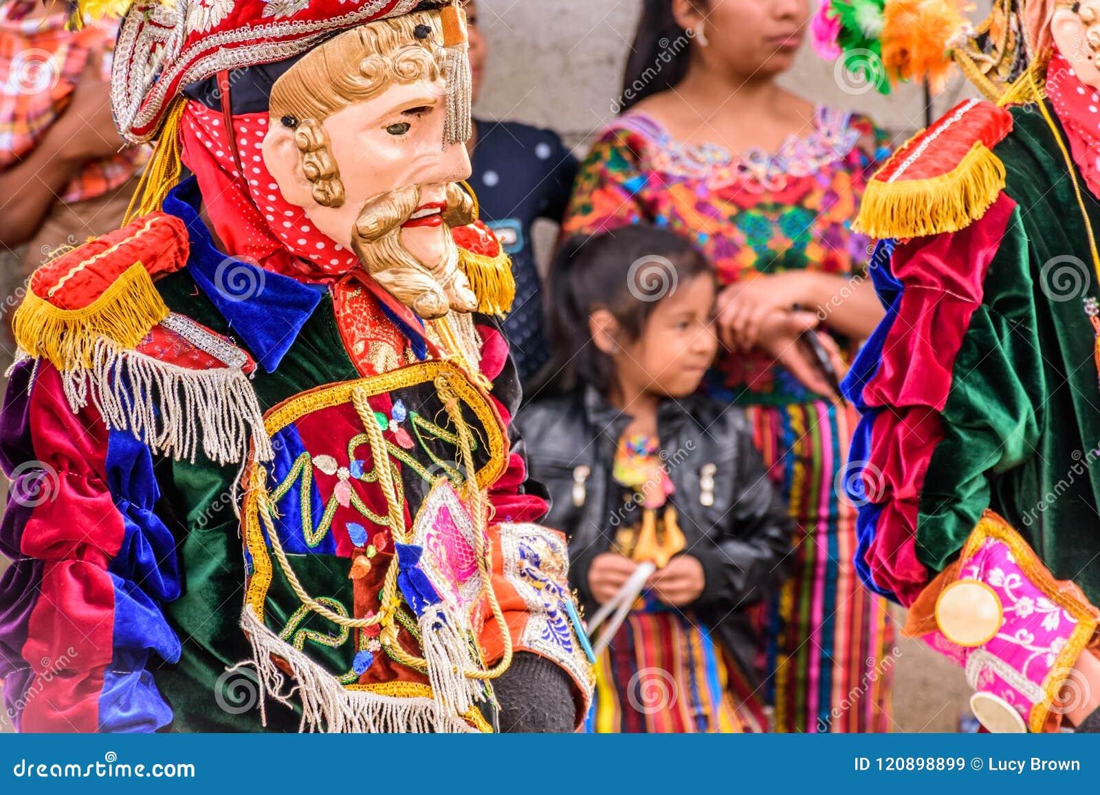 Traditional folk dancers in Spanish conquistador masks & costume