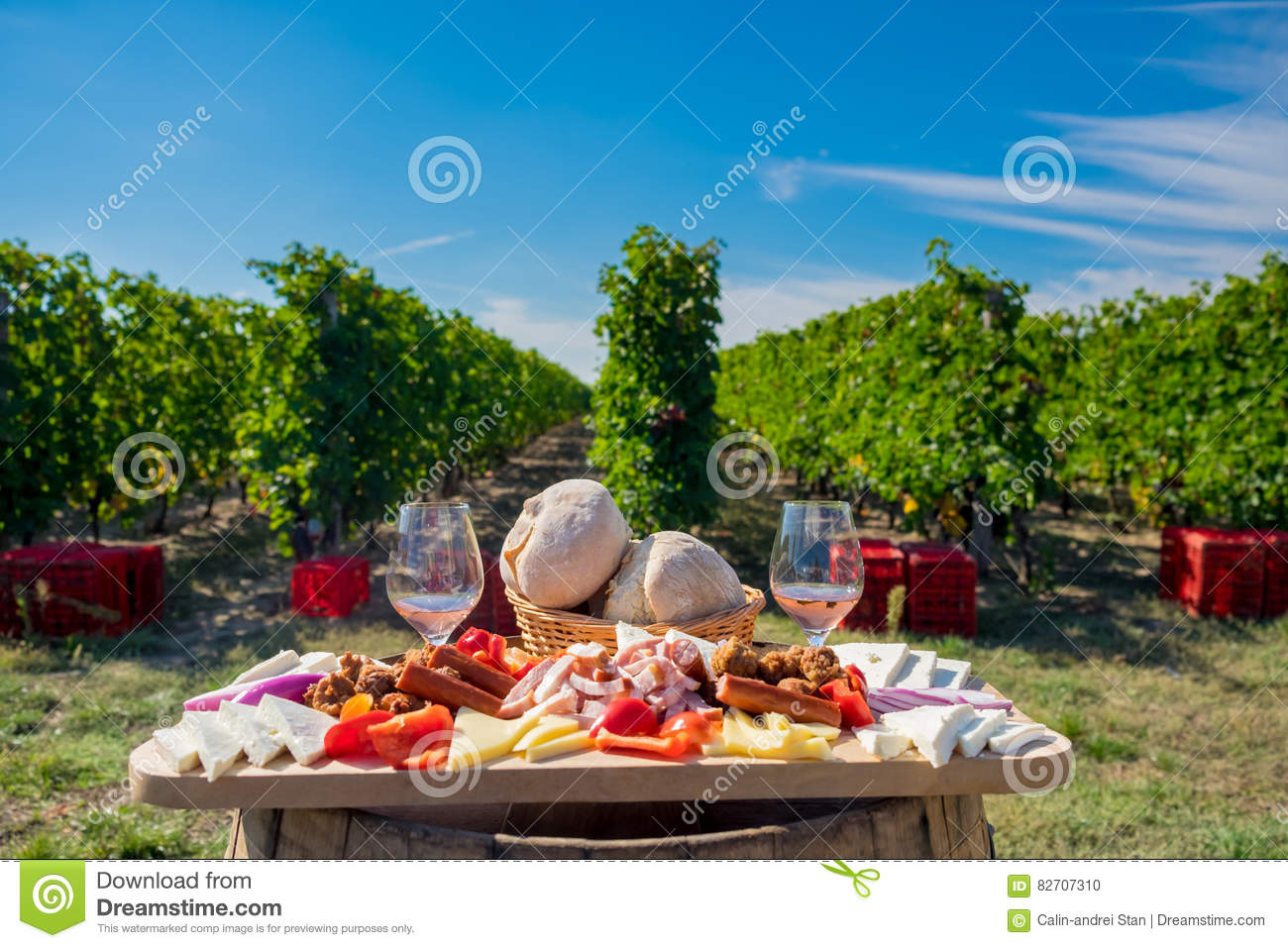 Traditional food plate with wine and vineyards in the background