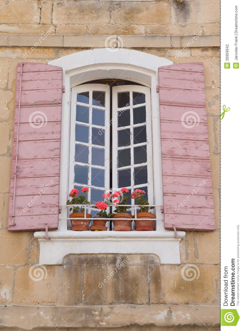 traditional french window with pink shutters stock
