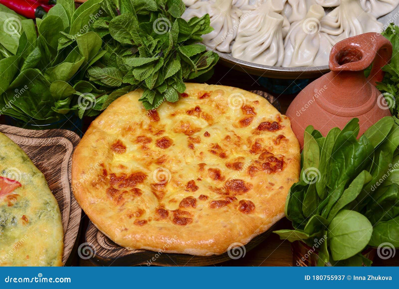 Traditional Georgian Kolkh Khachapuri With Suluguni And Brynza Cheese On The Table Khachapuri Megruli Homemade Baking Stock Image Image Of Lunch Bakery 180755937