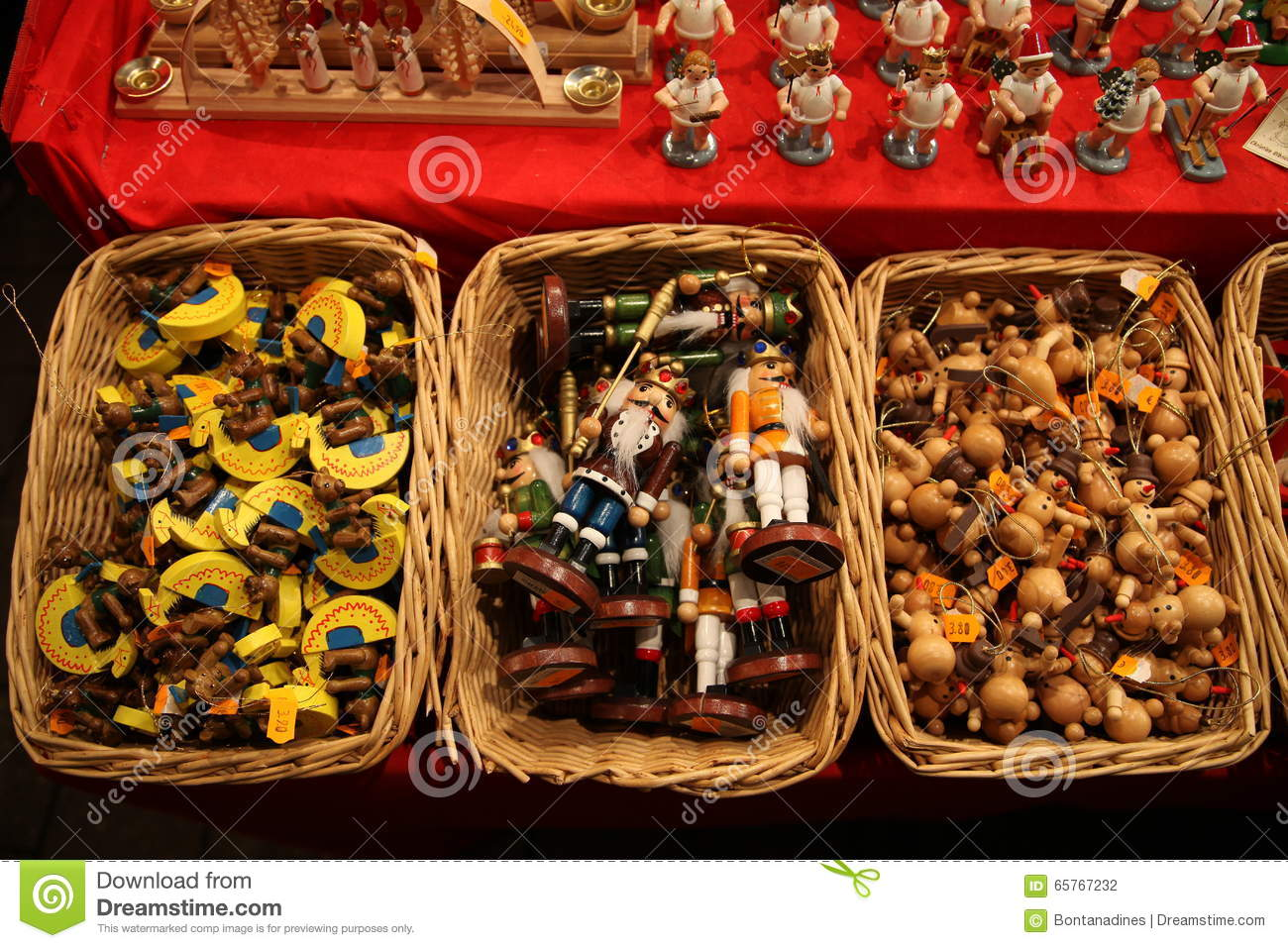 traditional german wooden christmas decorations in a wicker basket on a christmas fair - Traditional German Christmas Decorations