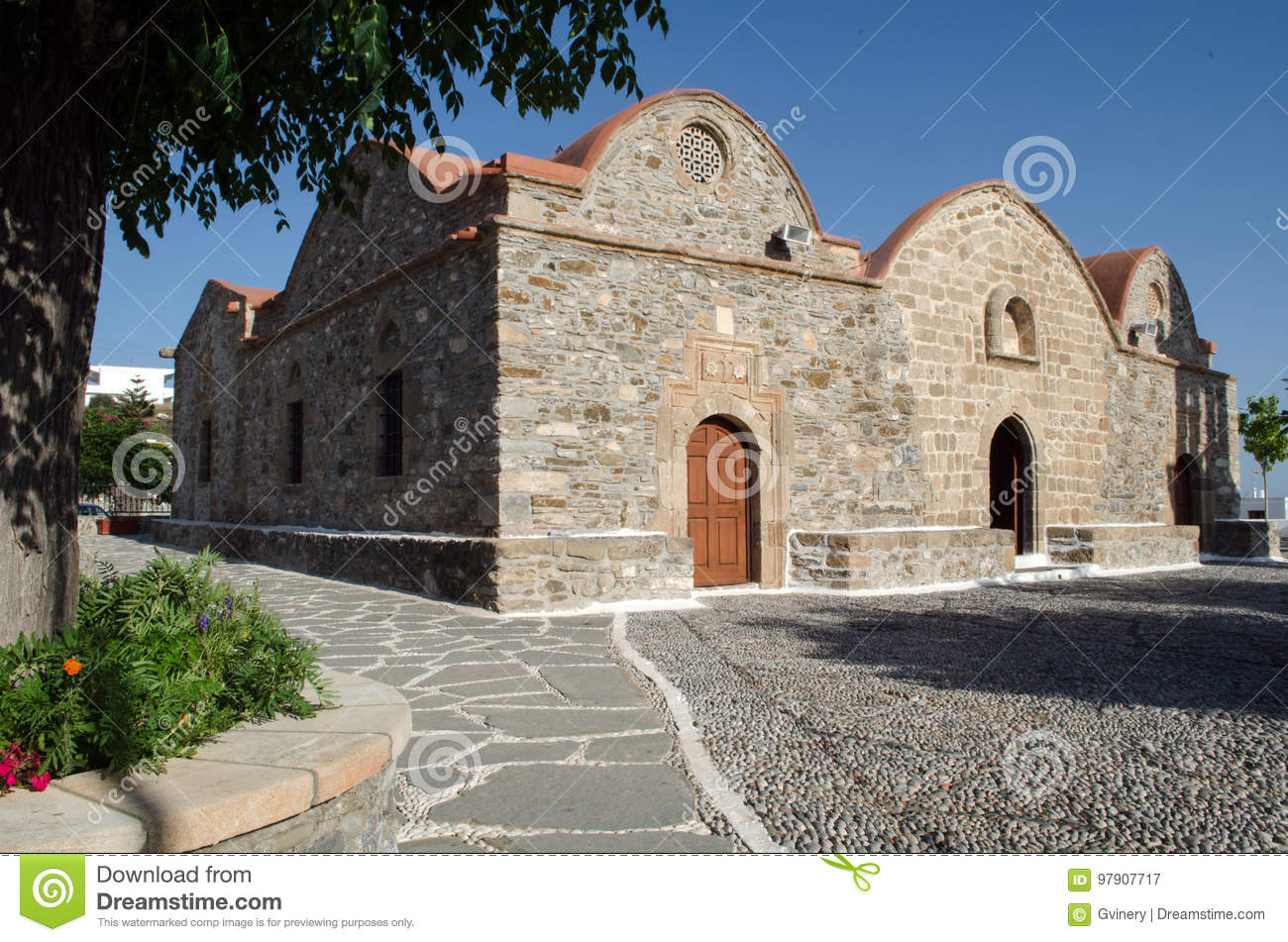 Traditional greek church made from stone, with red roof