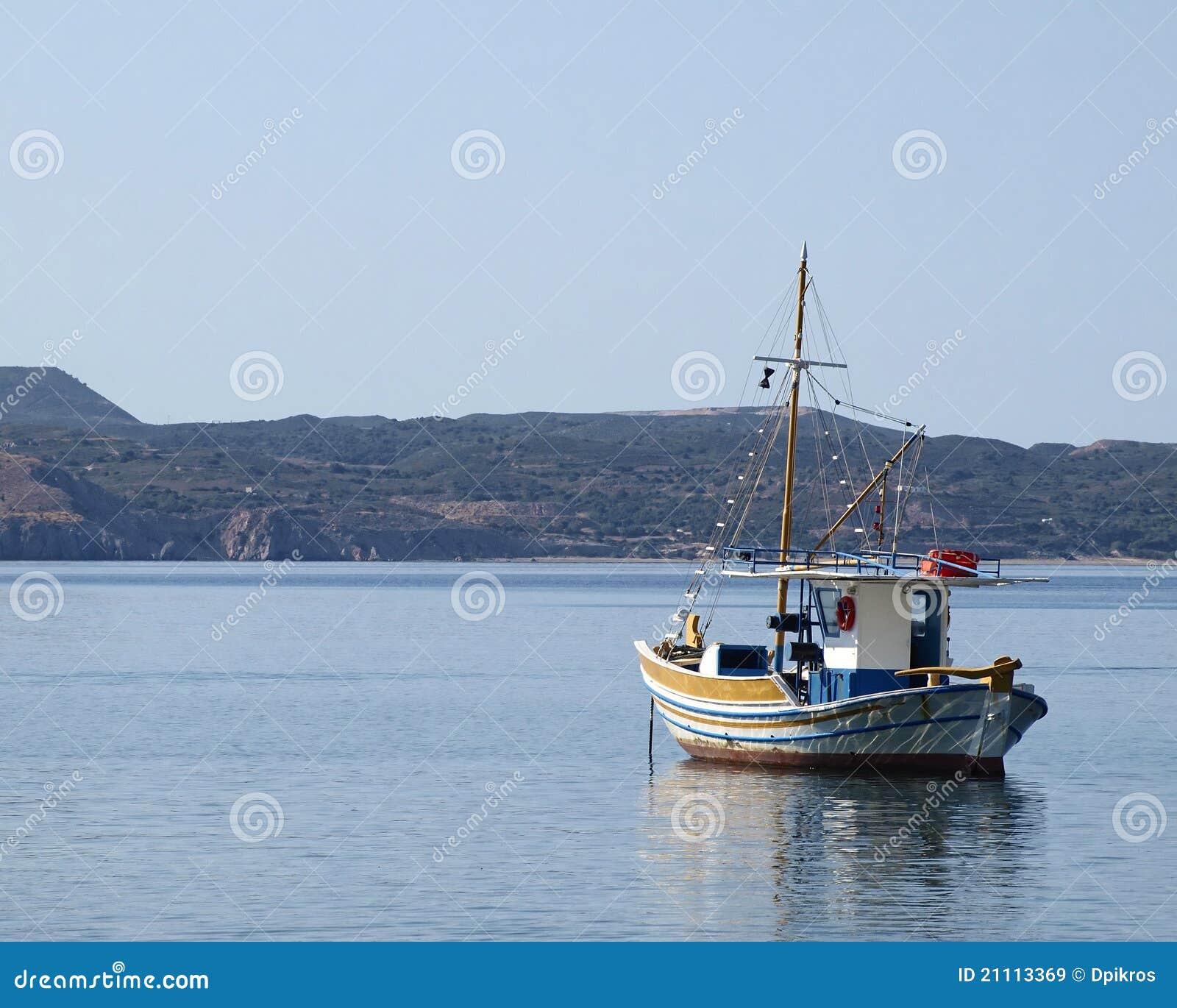 Traditional greek fishing boat kaiki royalty free stock for Free fishing boats