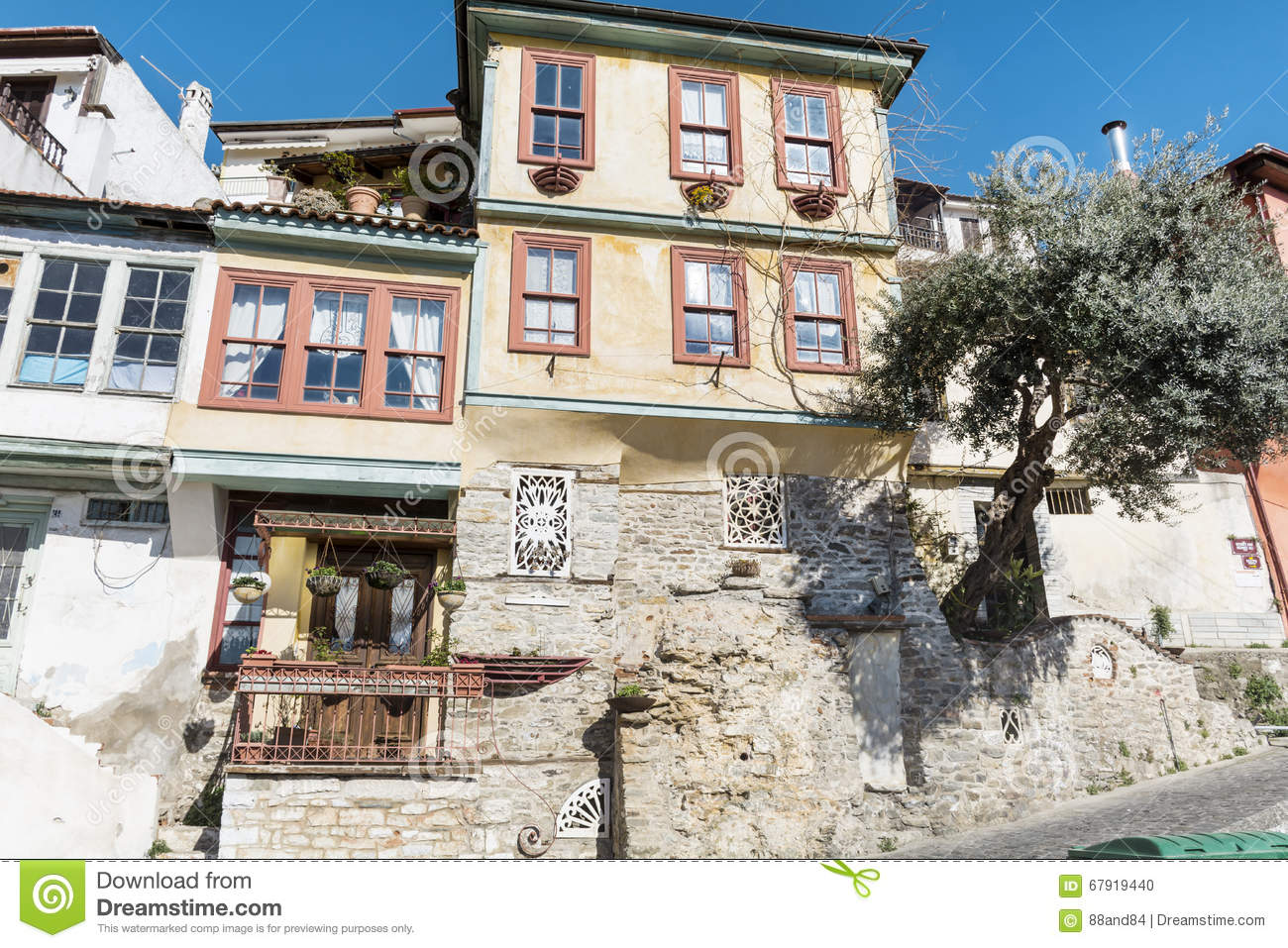 Traditional Greek Houses traditional greek houses in kavala stock photo - image: 67919440