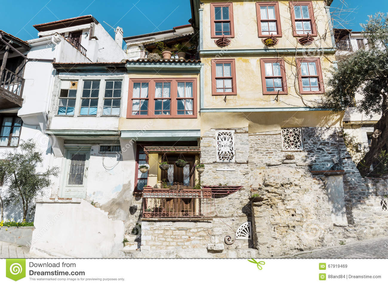 Traditional Greek Houses traditional greek houses in kavala stock photo - image: 67919469