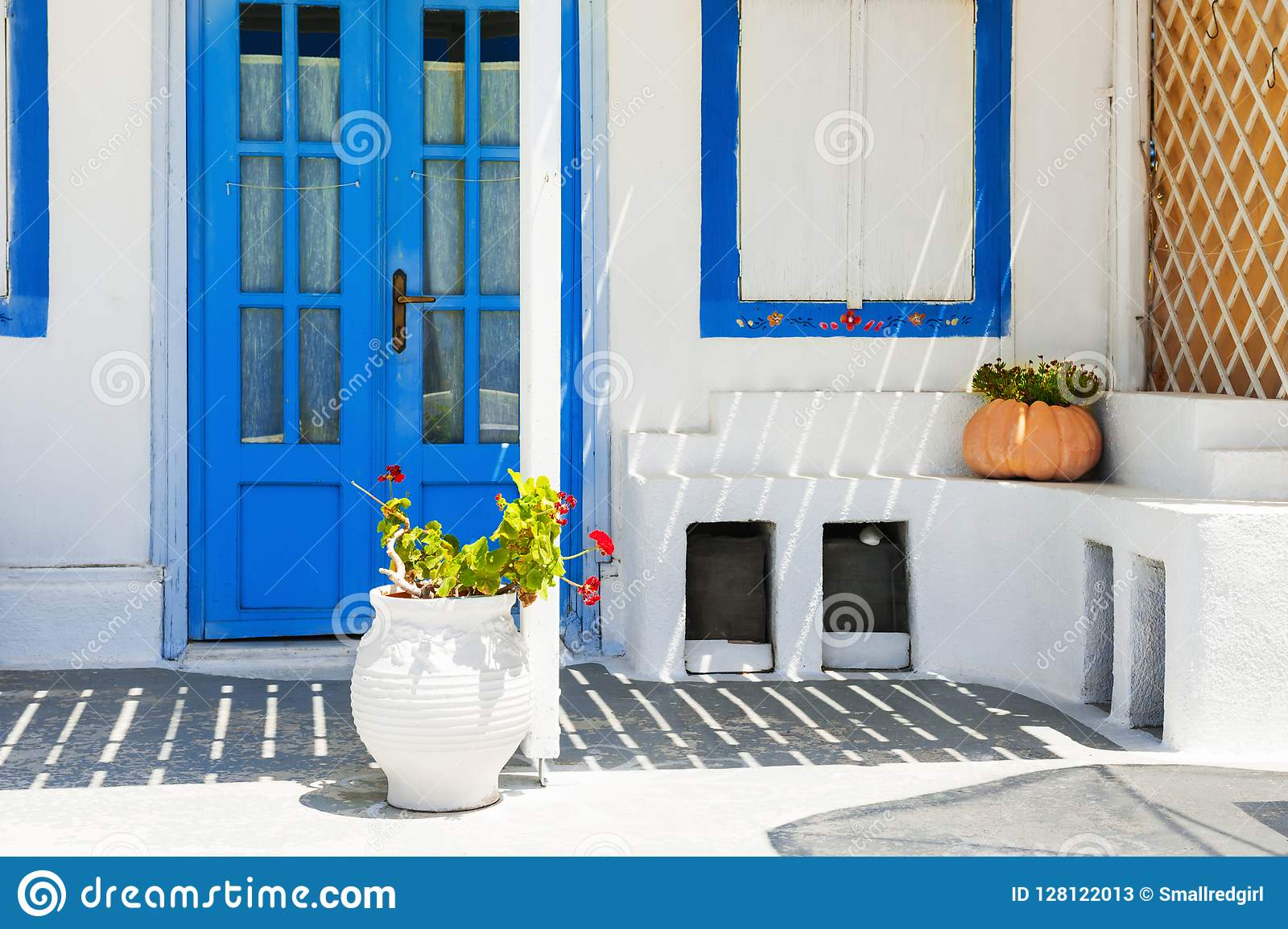Traditional greek white architecture with blue doors and windows