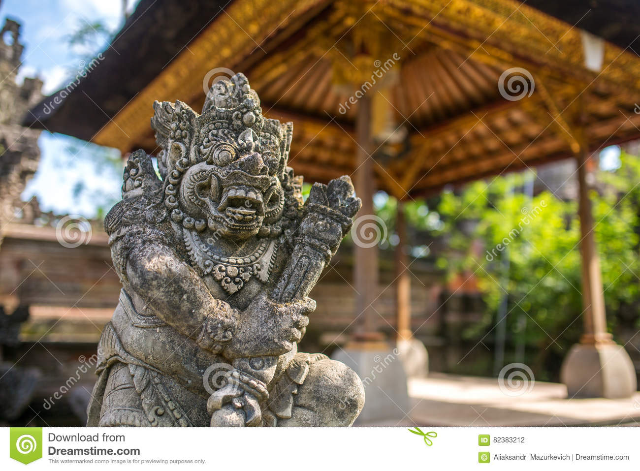 Traditional guard demon statue carved in dark stone stock