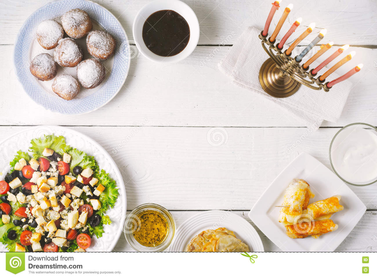 Traditional Hanukkah dishes on the white wooden table