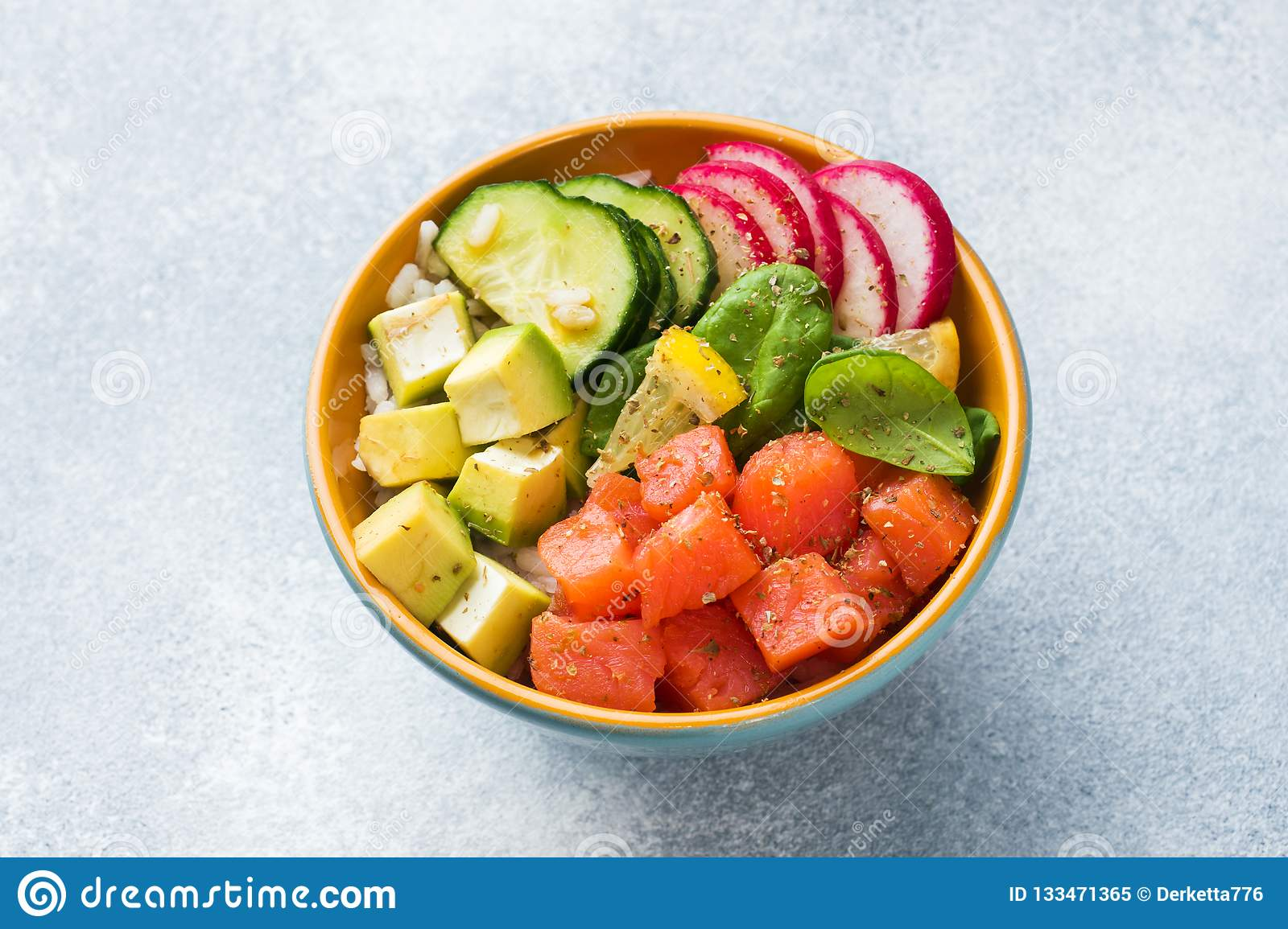 Traditional Hawaiian Poke Salad With Salmon Avocado Rice And Vegetables In A Bowl