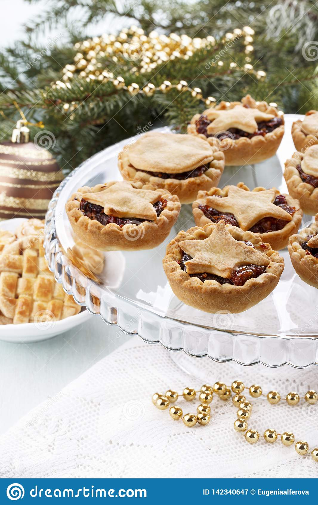 Traditional homemade fruit mince pies in Christmas decoration