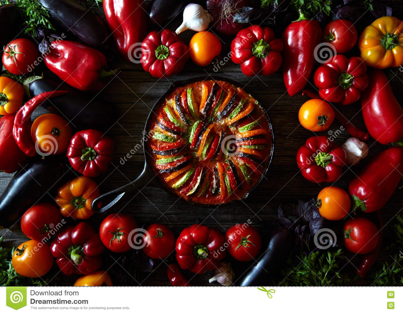 Traditional homemade ratatouille french vegetarian food vegetable. Assorted vegetables background. Top view