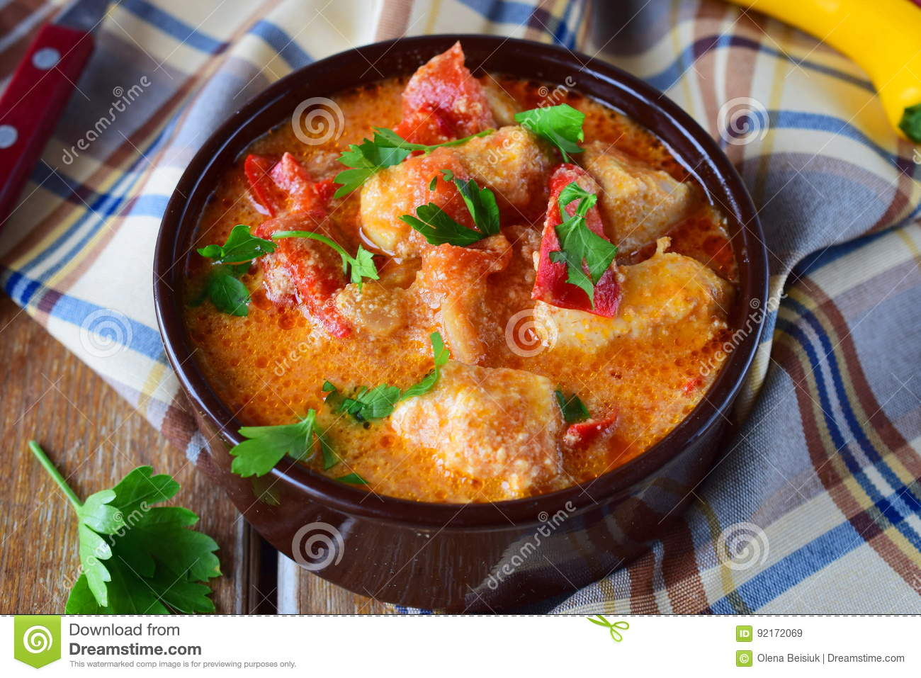 Traditional Hungarian dish witth paprika and chicken in a creamy sause In a ceramic pot. Healthy eating concept.