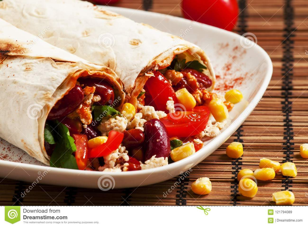 Traditional Mexican food, burritos with meat and beans, selective focus