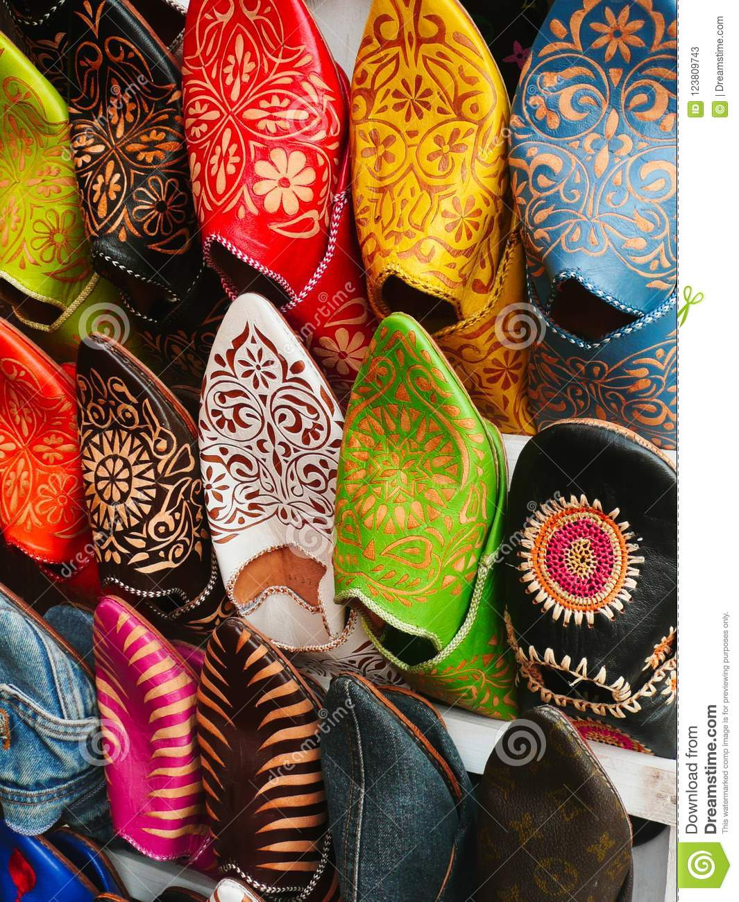 905f73b24df Traditional Moroccan shoes sold in a large variety of colours at the market  of Marrakesh