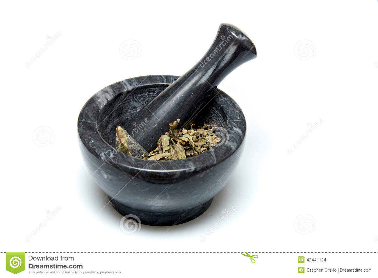 Traditional Mortar And Pestle With Herbs Stock Photo