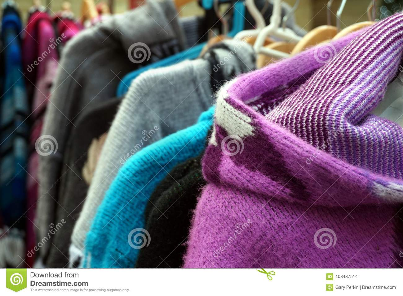 Traditional multi colored woolen knitwear clothes for sale on a market stall