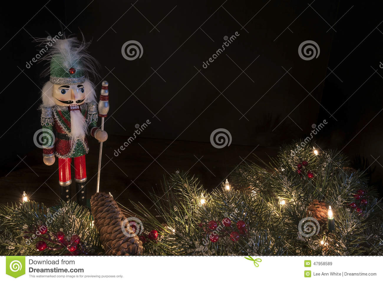 traditional nutcracker with decorative pine border and a