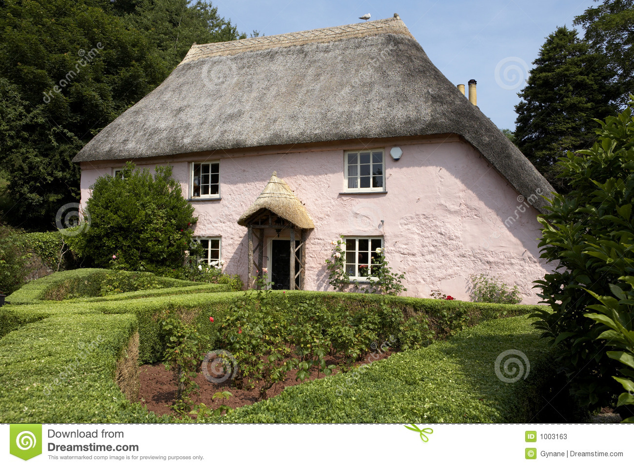 Traditional Pink Painted English Cottage Stock Photos