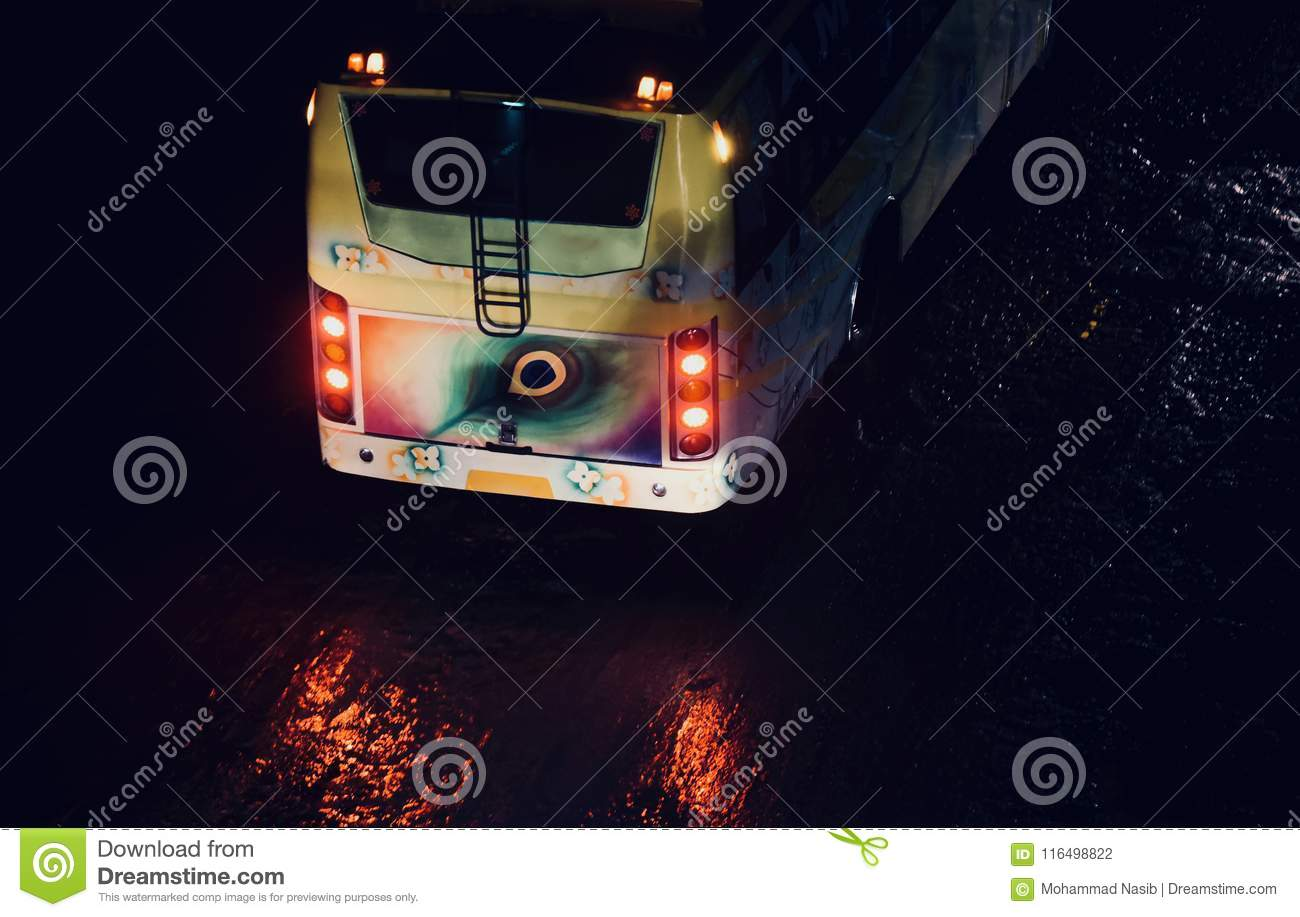 Download Traditional Public Bus Of India Running On A Wet Road Stock Photo - Image of backpart, road: 116498822