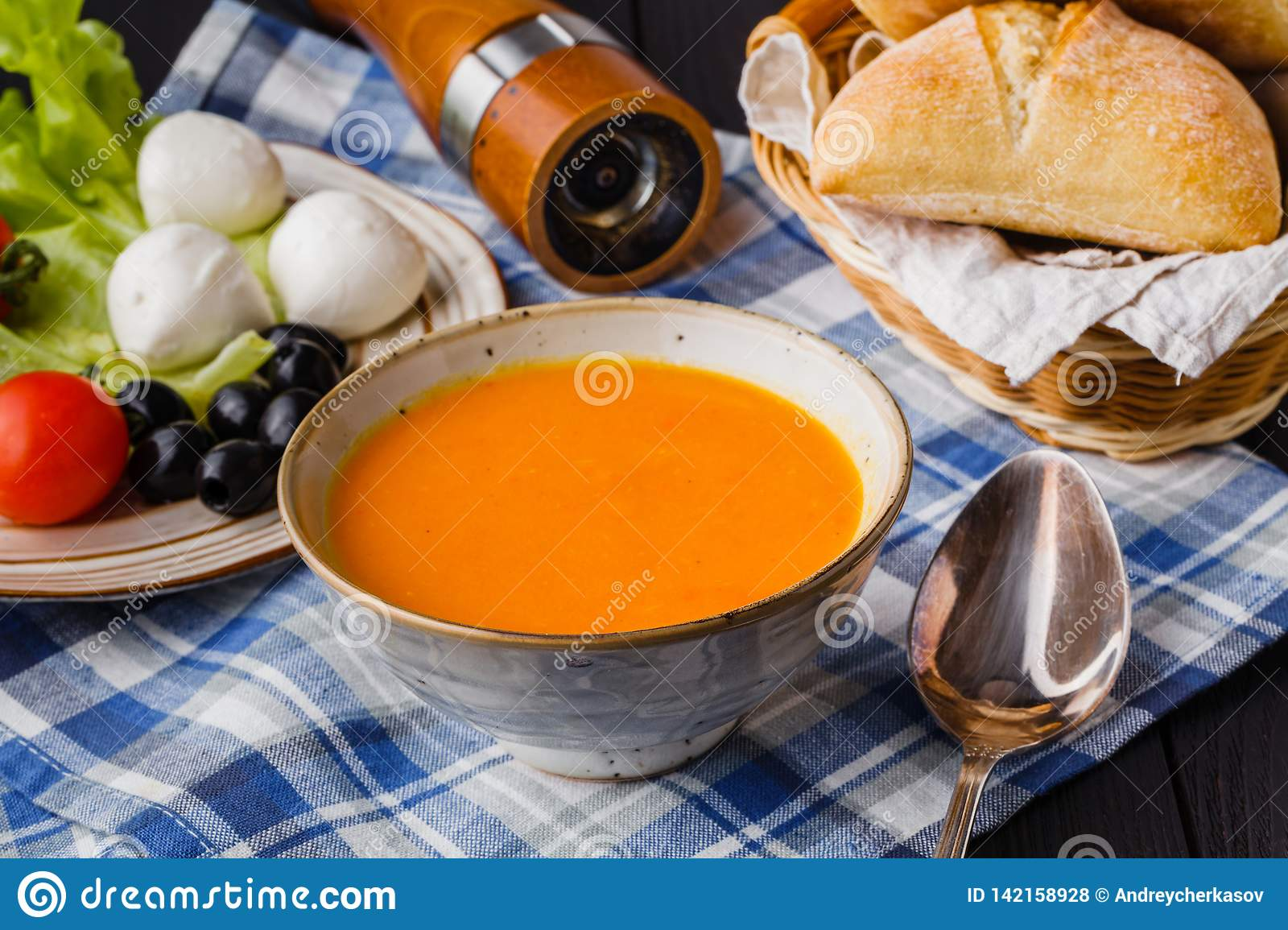 Traditional pumpkin soup, homemade with bread