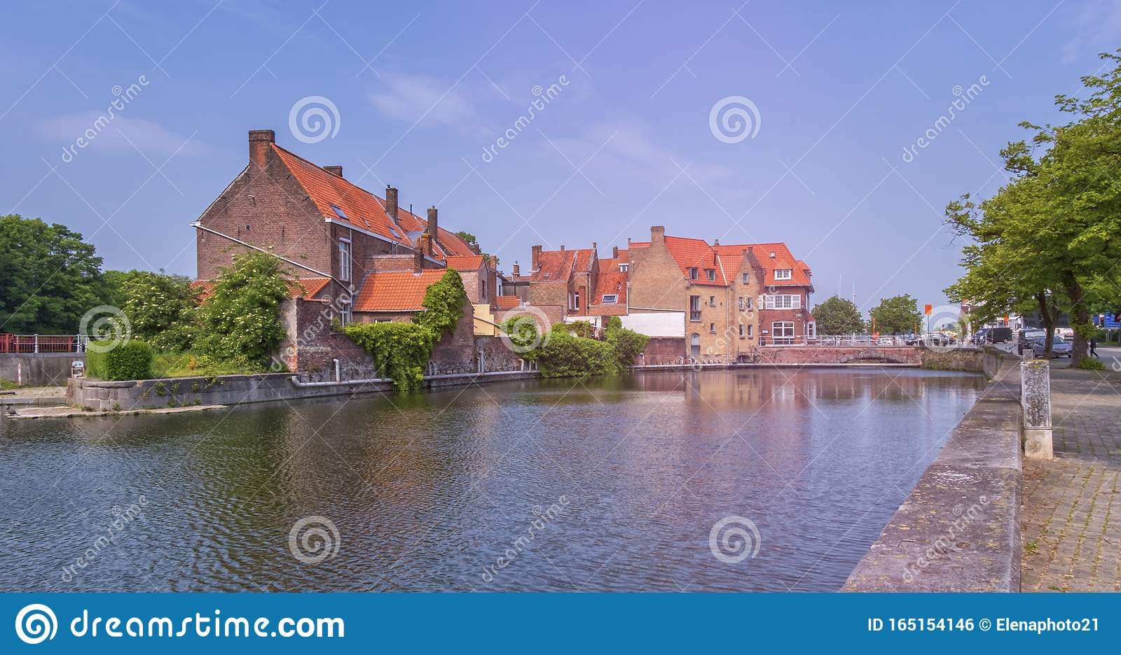 Traditional red brick house and canal in Bruges, Belgium