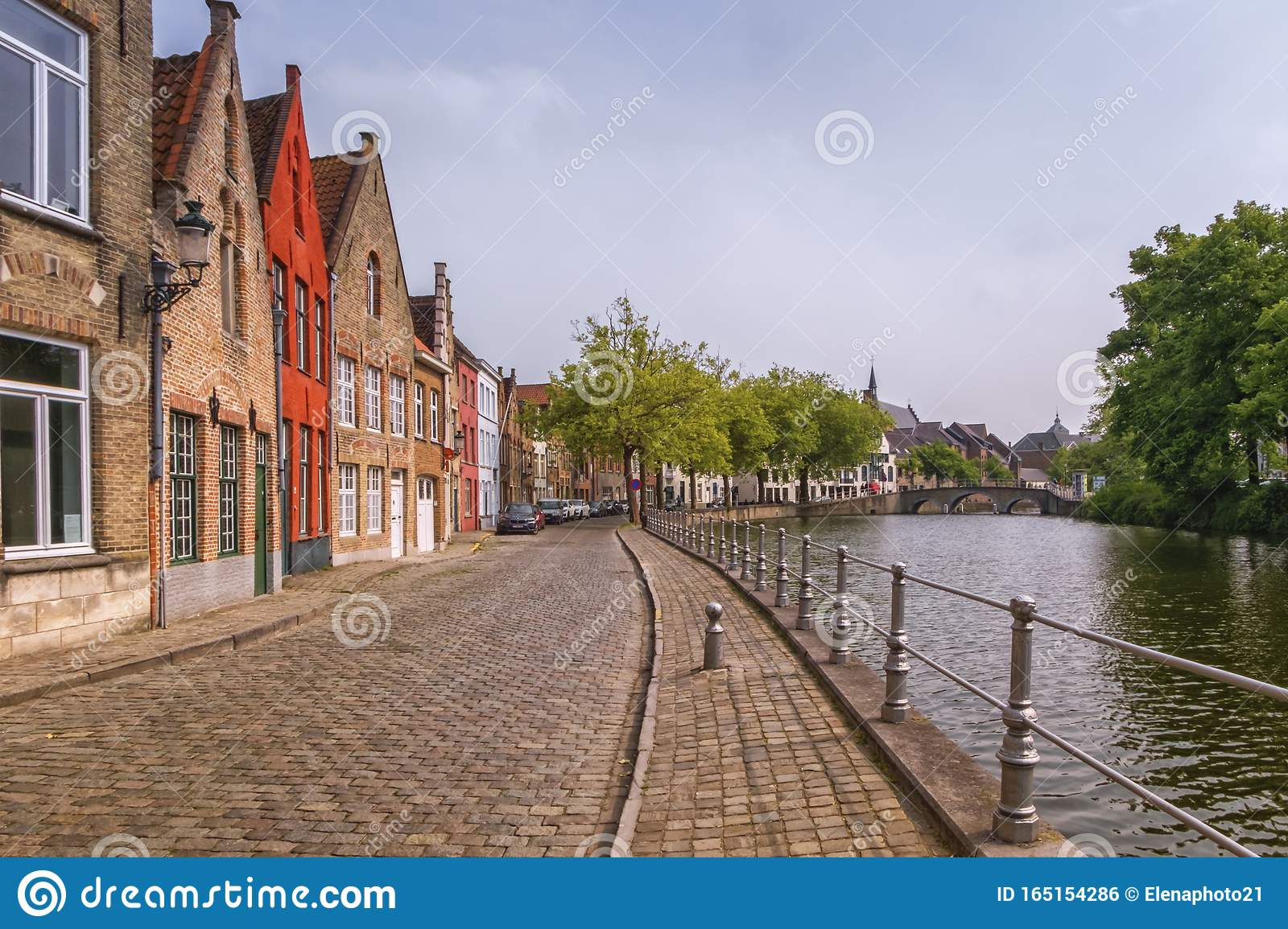 Traditional red brick houses and canal in Bruges, Belgium