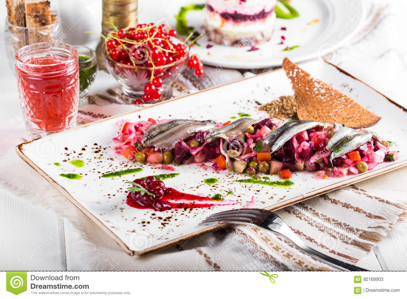 Traditional Russian and Ukrainian vegetable salad Vinaigrette on a served table