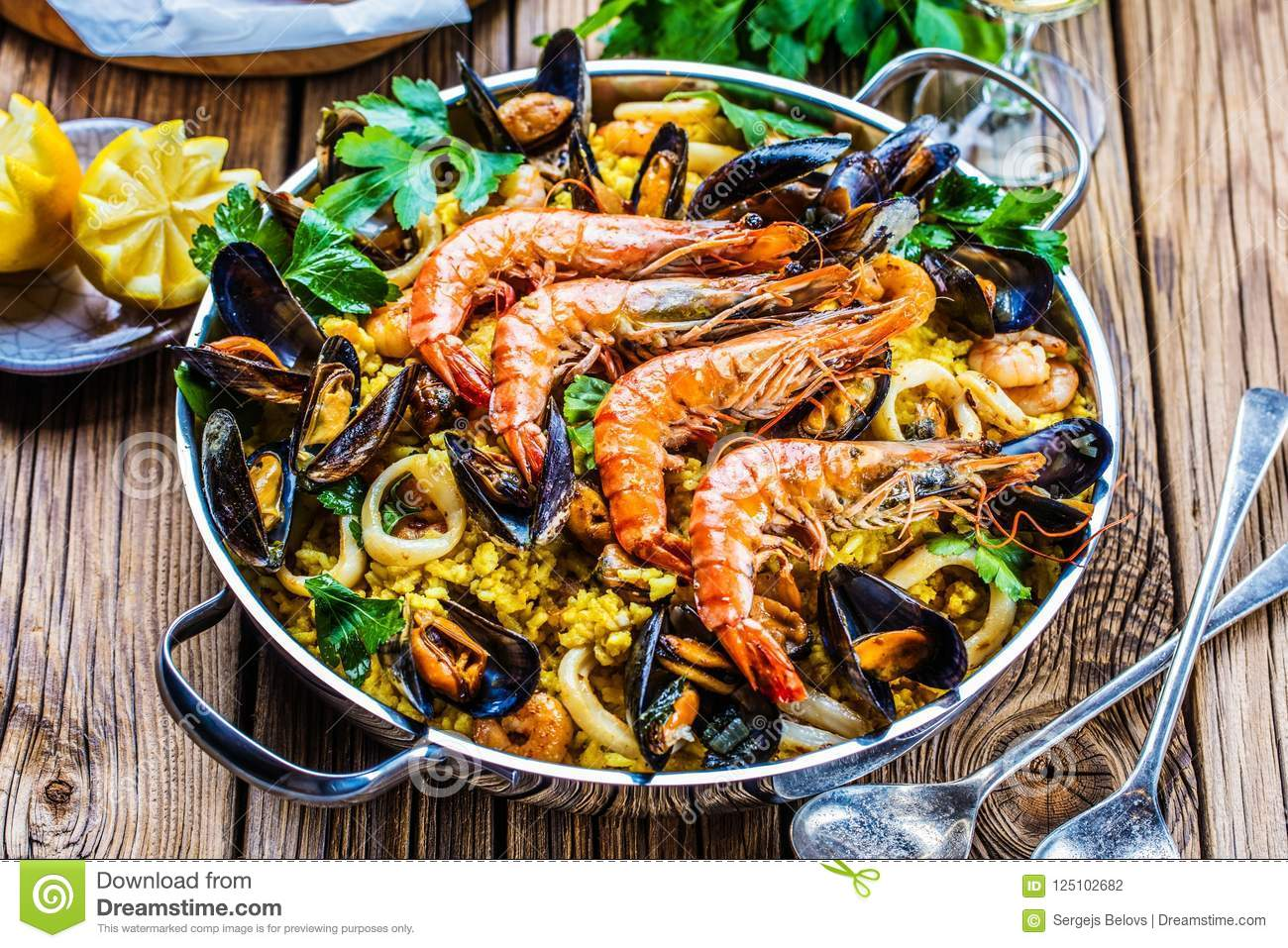 Seafood Paella in the man on a white table with decoration