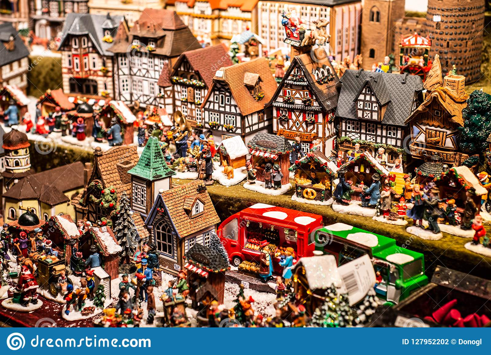 Traditional Souvenirs and toys like smal model houses At European Winter Christmas Market Wooden Souvenir