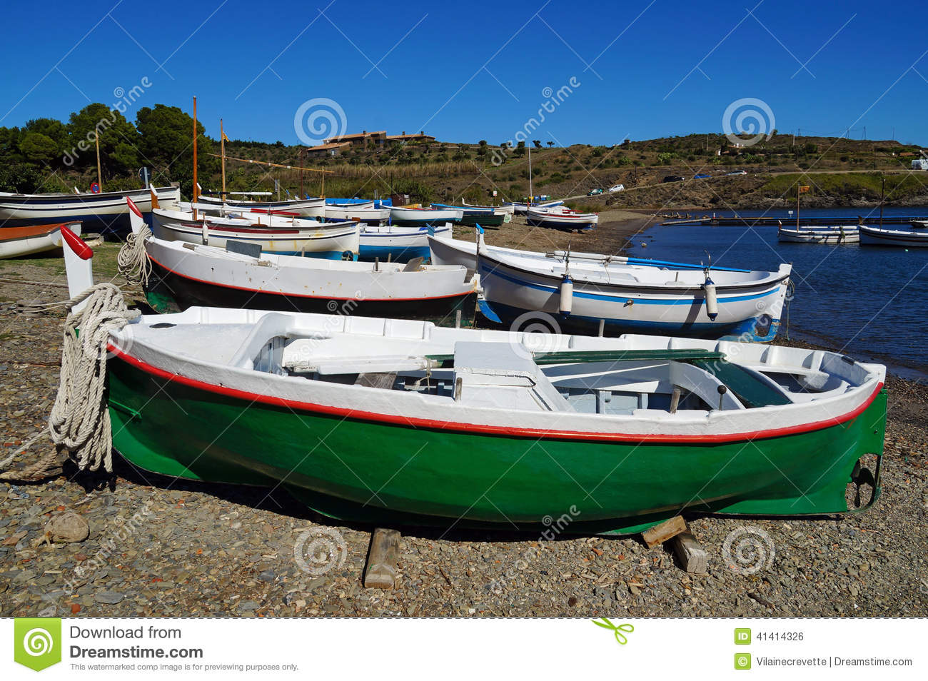 Traditional spanish fishing boats on the beach stock photo for Sea fishing boats