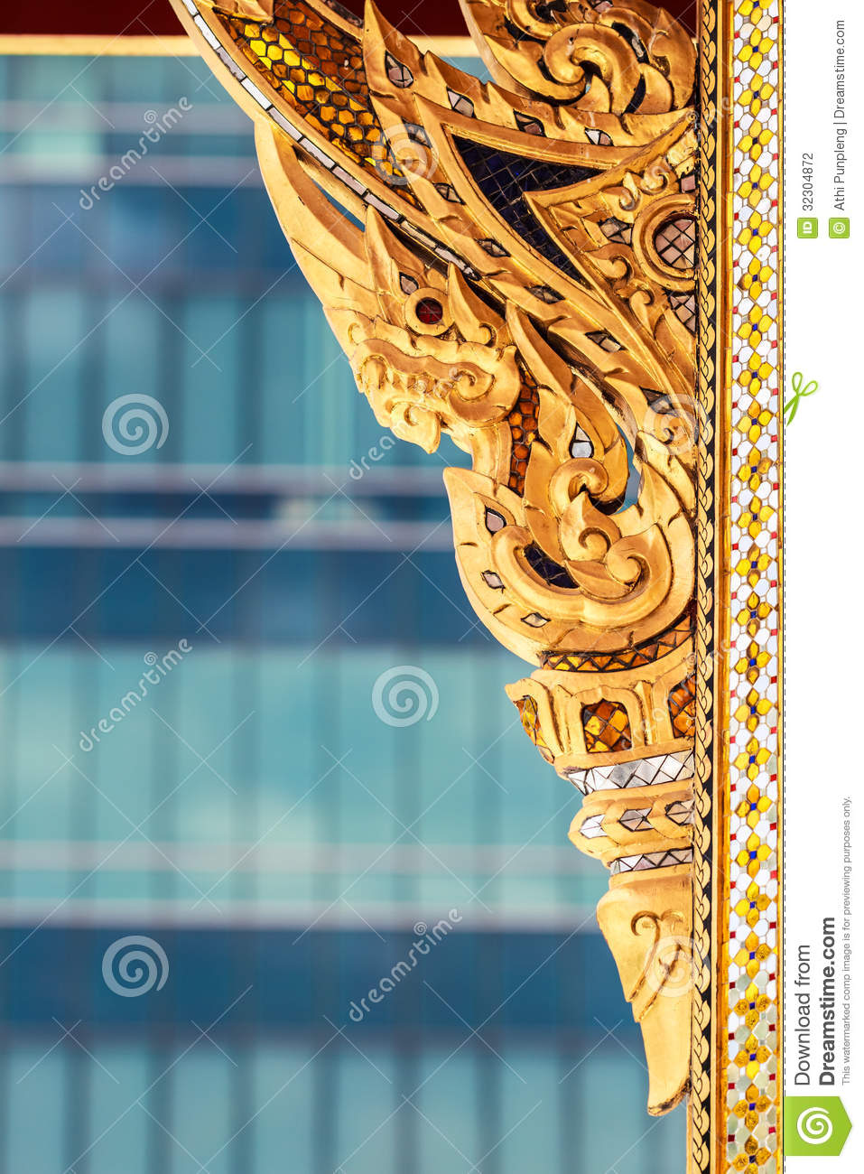 traditional thai wooden carving in gold color stock
