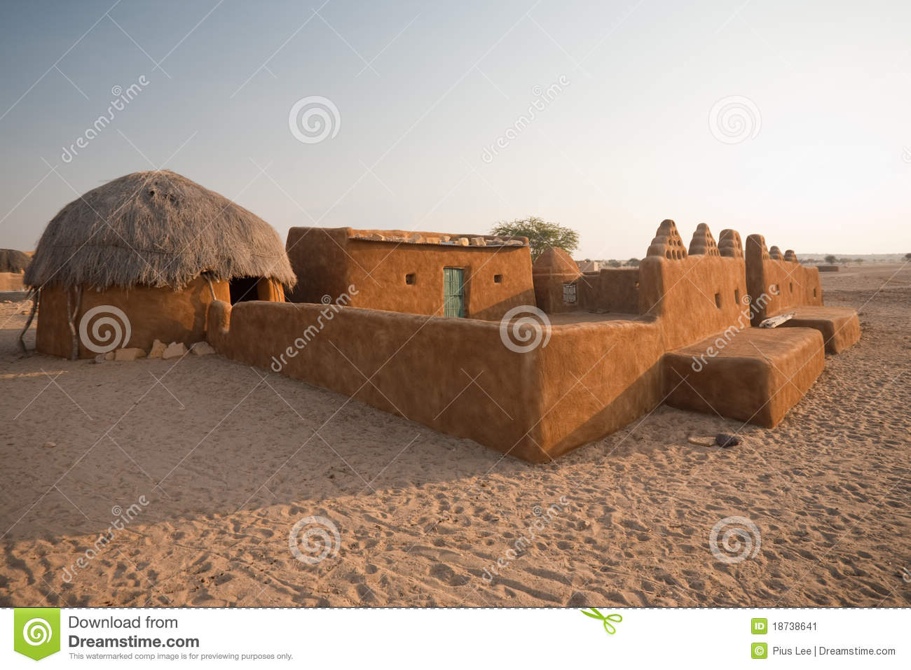 Traditional thatched mud huts stock image