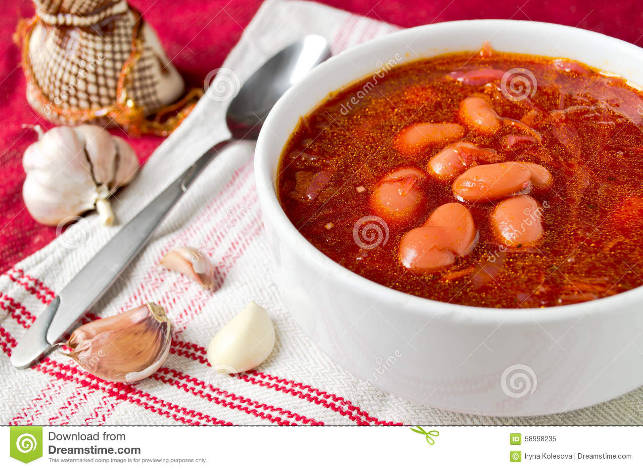 Traditional Ukrainian beetroot soup - red borsch with bean and garlic.