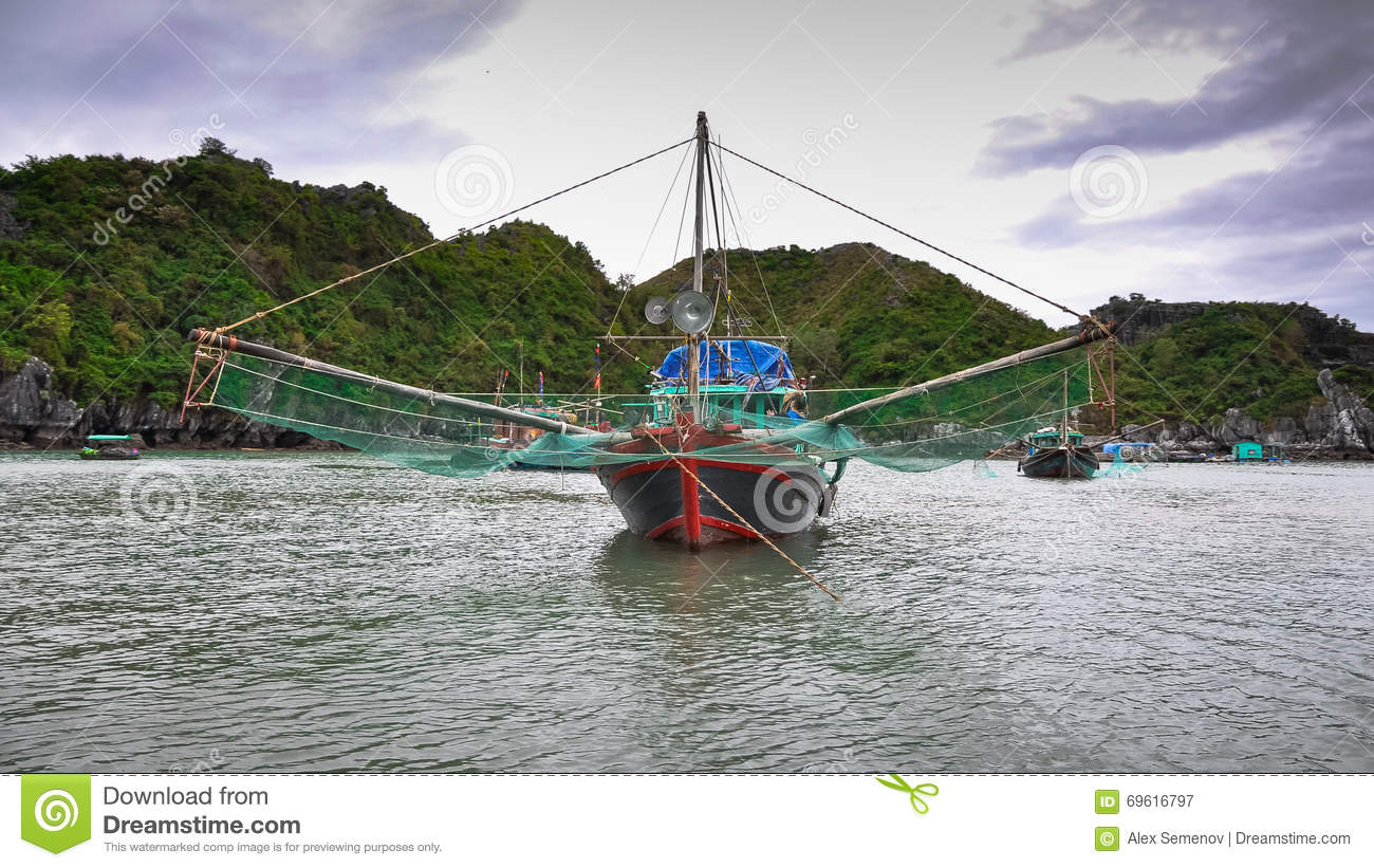 Traditional vietnamese fishing boats with large nets stock for Large fishing boats