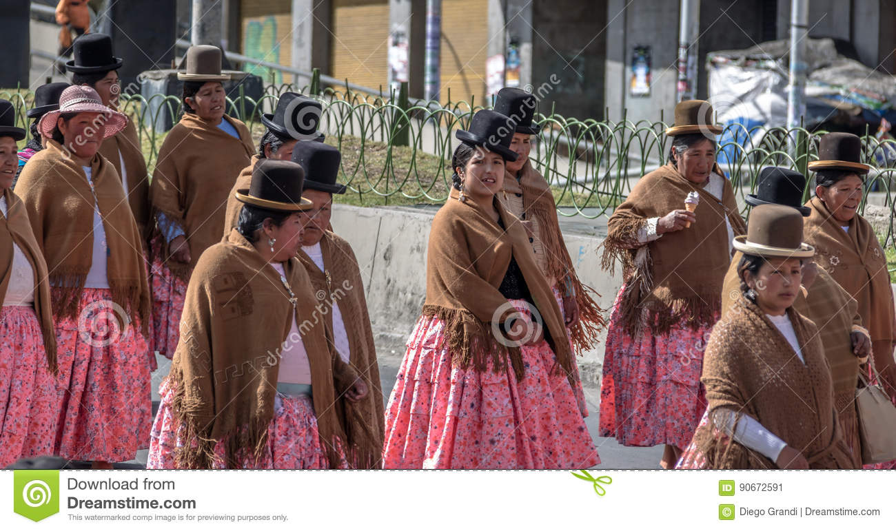 Traditional Women Cholitas In Typical Clothes During 1st Of May