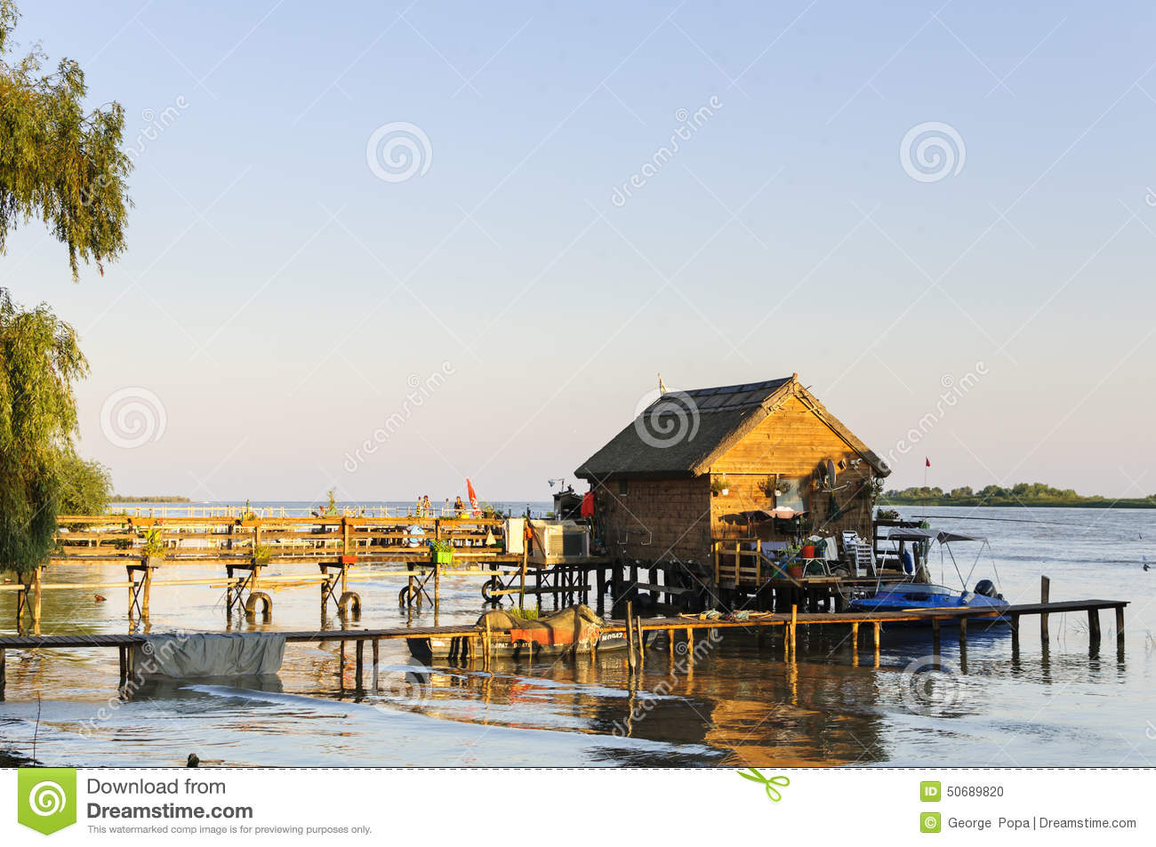 Wood pontoon and traditional boat royalty free stock image 50689468 - Household water treatment a traditional approach ...