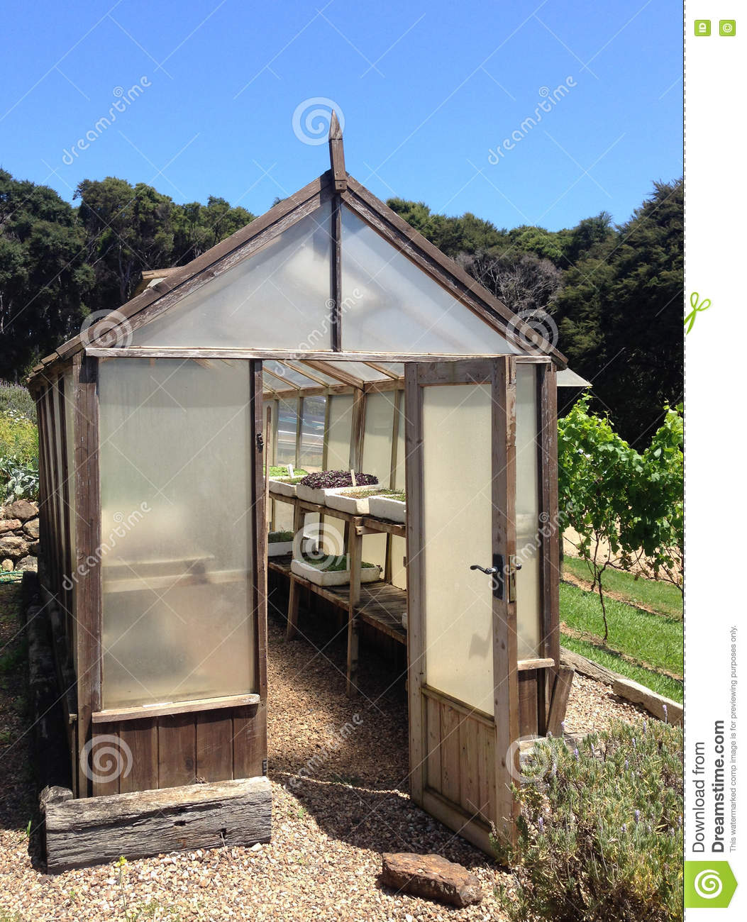 Traditional Wooden Greenhouse In A Garden Stock Image