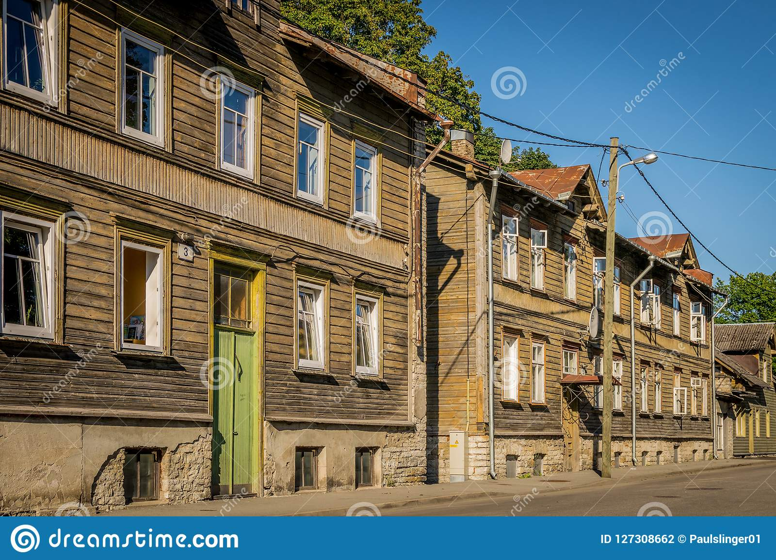 A Row Of Wooden Terraced Houses Stock Photo - Image of
