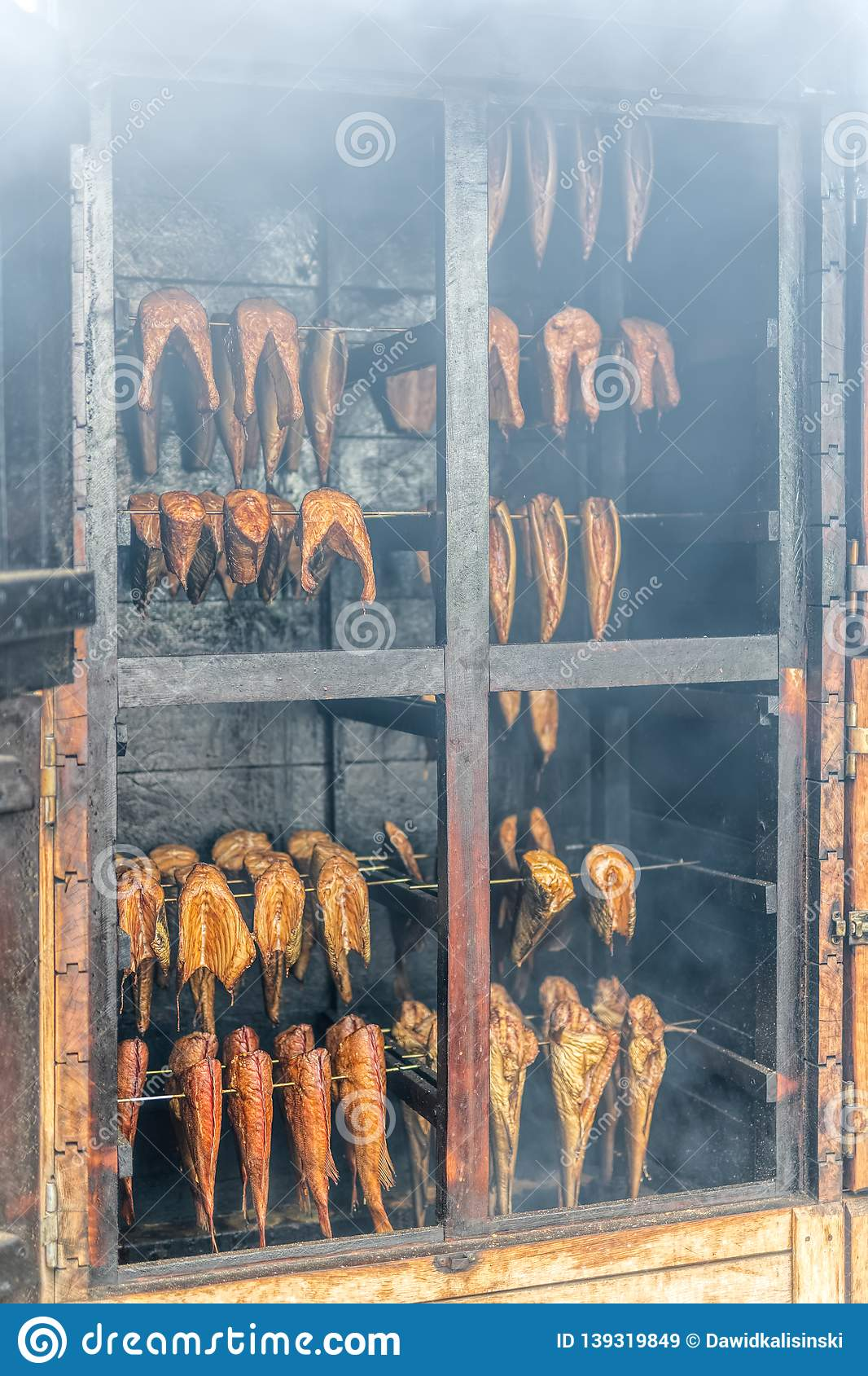 Traditionally hot smoked fishes in retro style smokehouse