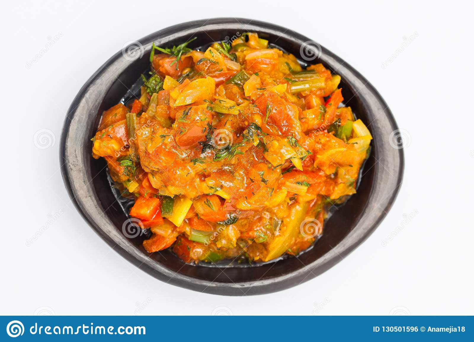 Traditionell colombiansk sås som kallades hogaoen, tjänade som i en svart keramisk maträtt
