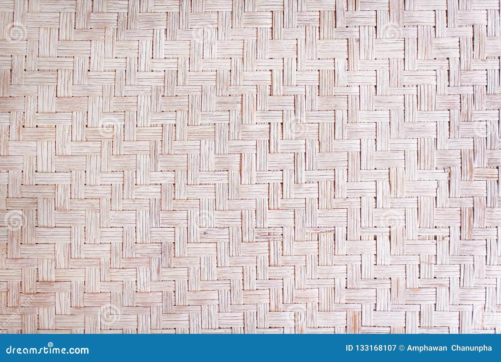 Tradycyjny handcraft wysuszona płocha wyplatającą matową teksturę, natura wzory na tle